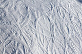 Ski traces on snow in mountains — Stock Photo