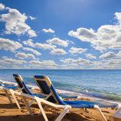 Beach chairs on beach — Stock Photo