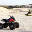 Quad bike in desert — Stock Photo