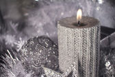 Christmas candle with decoration — Stock Photo