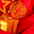Golden christmas decoration and gift — Stock Photo