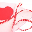 Envelope with red hearts ribbon — Stock Photo