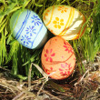 Easter eggs on green grass and hay — Stock Photo #39763997