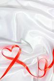 Red ribbon heart — Stock Photo