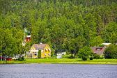 Swedish houses near lake — Stock Photo