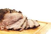 Roast pork on a wooden board — Foto de Stock