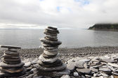 Stack of stones on fjord background — Stock Photo