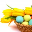 Easter eggs in basket with tulips — Stock Photo #9757553