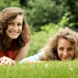 Teens lying in a grass — Stock Photo