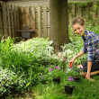 Teenager gardening — Stock Photo