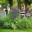 Girls at the cemetery - Stock Photo