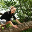 Teen in a tree — Stock Photo