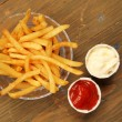 Stock Photo: French fries with condiment