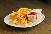 French fries with condiment — Stock Photo