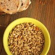 Sunflower seeds and bread - Stock Photo