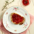 Strawberry jam on toast -  