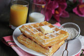 Waffles with powered sugar — Stock Photo