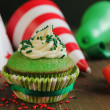 Green birthday cupcake — Stock Photo