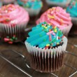 Stock Photo: Blue and pink cupcakes