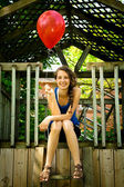 Teen holding a red balloon — Stock Photo