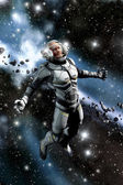 Astronaut and asteroid field — Stock Photo
