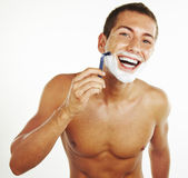 Young man shaving in the bath — Stock Photo