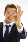Portrait of handsome young man gesturing okay sign — Stock Photo