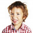 Little boy sticking out his tongue — Stock Photo #13445342