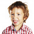 Little boy sticking out his tongue — Stock Photo