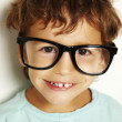 Постер, плакат: Little boy with glasses