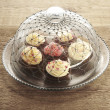 Foto Stock: Cupcakes in glass pastry