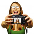 Royalty-Free Stock Photo: Beautiful young woman taking picture of herself