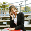 Closeup of happy business woman talking on cellphone — Stock Photo
