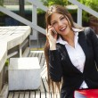 Closeup of happy business woman talking on cellphone - Zdjcie stockowe