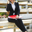 Closeup of happy business woman talking on cellphone - Foto Stock