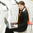 Beautiful business woman with laptop working outdoor — Stock Photo