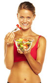 Beautiful sport woman eating salad — Stock Photo