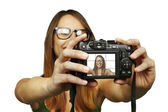 Beautiful young woman taking picture of herself — Stock Photo