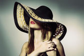 Attractive elegant sexy woman with black hat — Stok fotoğraf
