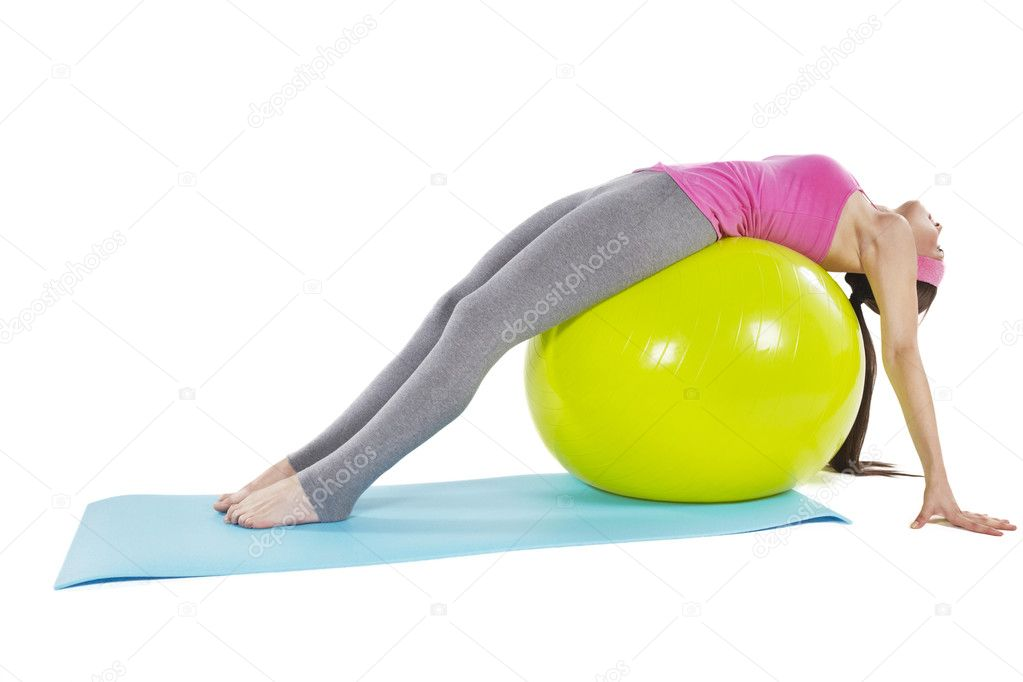 Young happy woman doing fitness exercise with fitness ball, isolated on white — Stock Photo #13604162