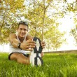 Sport man stretching at the park - fitness concepts — Stock Photo