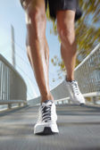 Sport man running. background in motion — Stock Photo