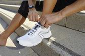 Man tying sports shoes — Stock Photo