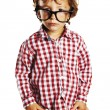 Stock Photo: Child with rimmed glasses and hands in pockets