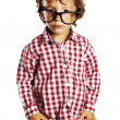 Child with rimmed glasses and hands in pockets - Stock Photo
