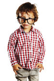 Child with rimmed glasses and hands in pockets — Stock Photo