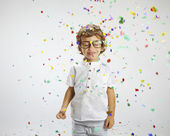 Beautiful child with rimmed glasses and confetti — Stok fotoğraf