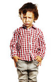 Angry child with hands in pockets — Stock Photo