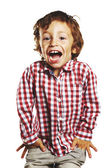 Laughing child with hands in pockets — Stock Photo