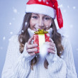 Smiling young Christmas woman with a gift — Stock Photo